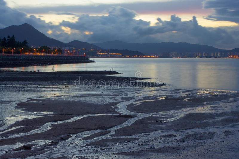 Sunset over mudflat. Hong Kong, China royalty free stock photography