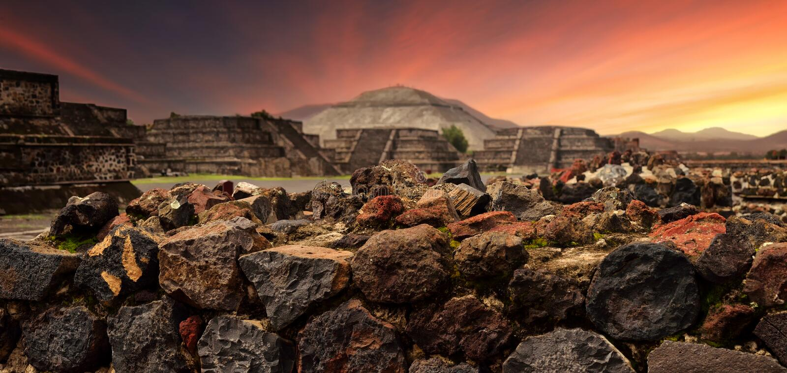 Sunset over the mystical ruins of the ancient Mayan city of Teotihuacan. Panoramic view royalty free stock images