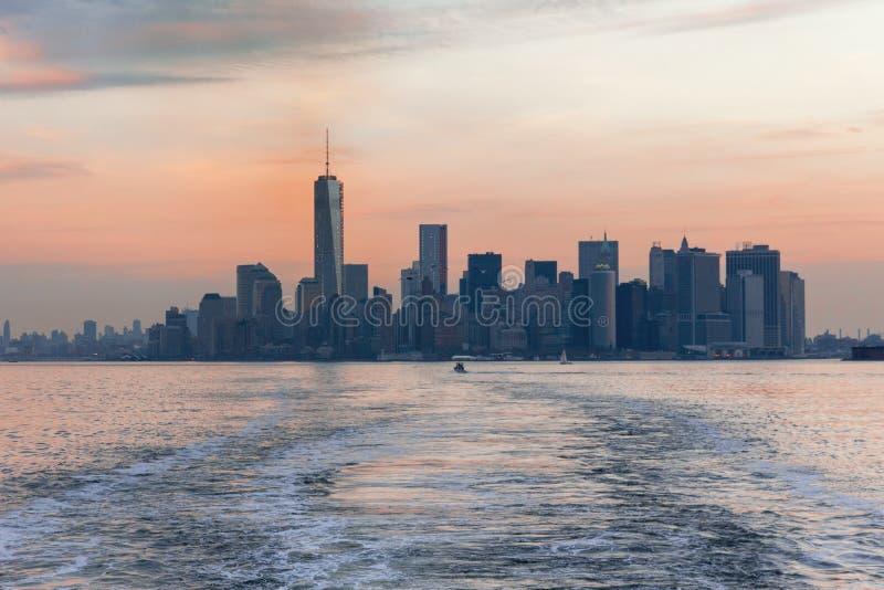 Sunset over New York Manhattan royalty free stock photography