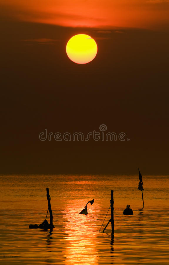 Download Sunset over ocean stock photo. Image of silhouette, season - 14879714