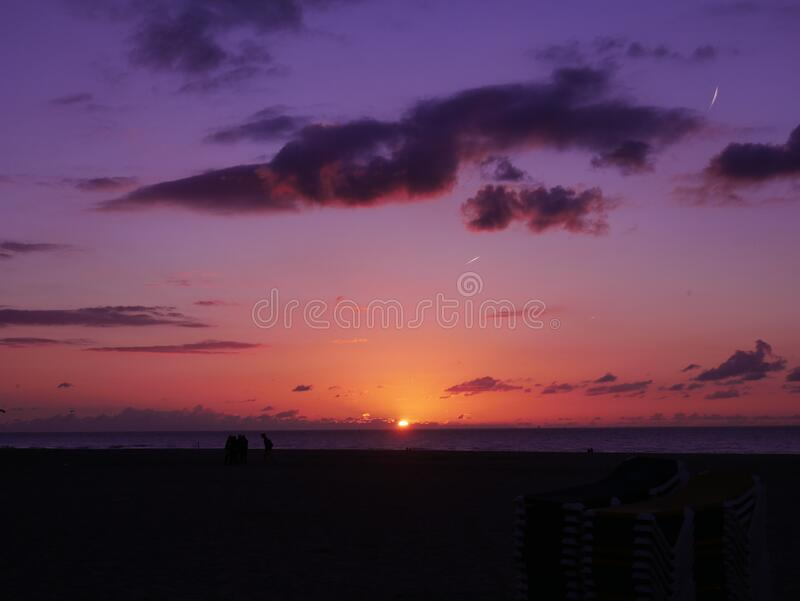Sunset over ocean horizon stock images