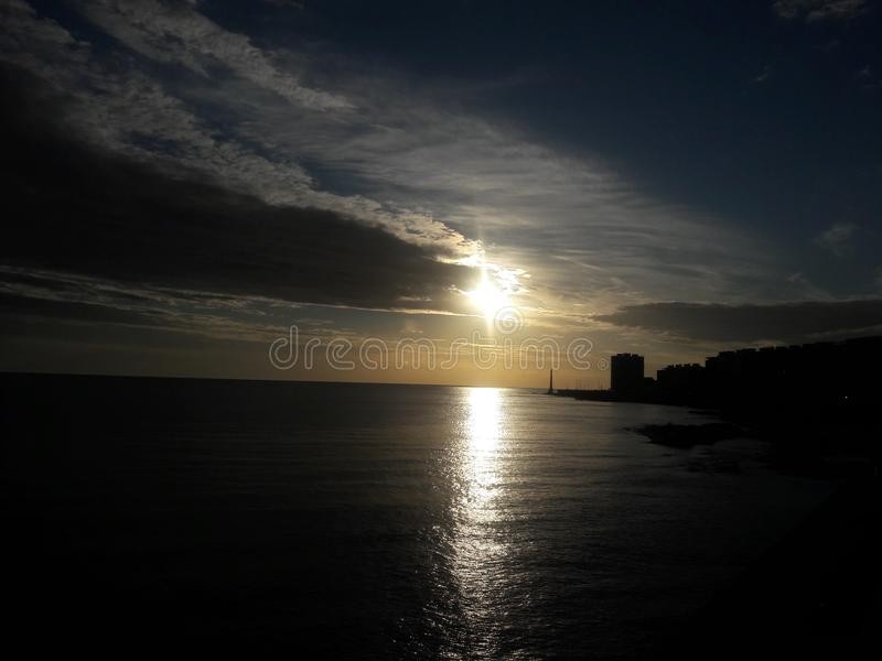 Sunset over ocean Montevideo Uruguay. Sea, coast, dusk, clouds, sky, ssouth, america, travel, tourism stock photography
