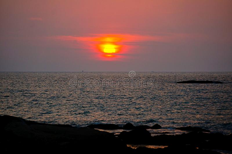 sunset over the ocean at thailand stock photography