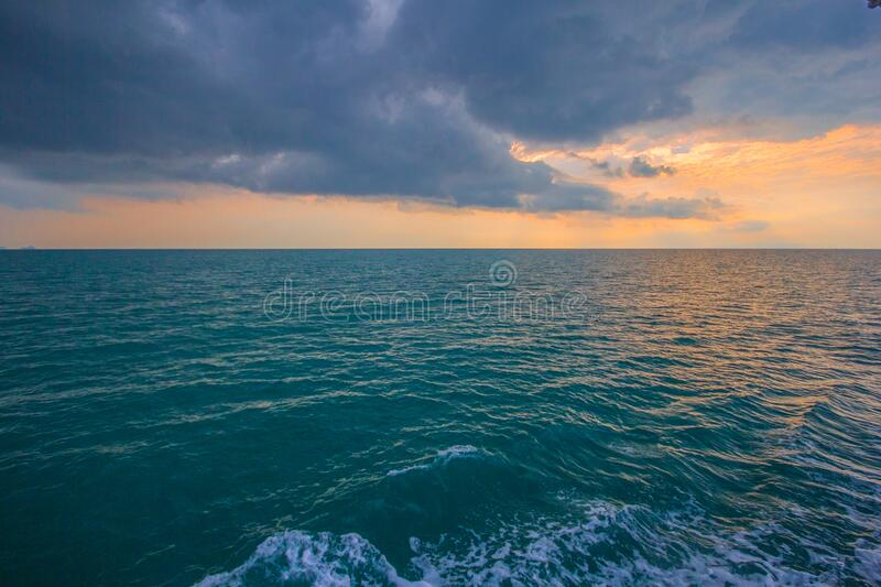 Sunset over ocean waves royalty free stock image
