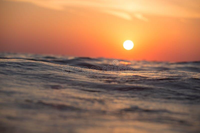 Sunset over ocean waves stock photo