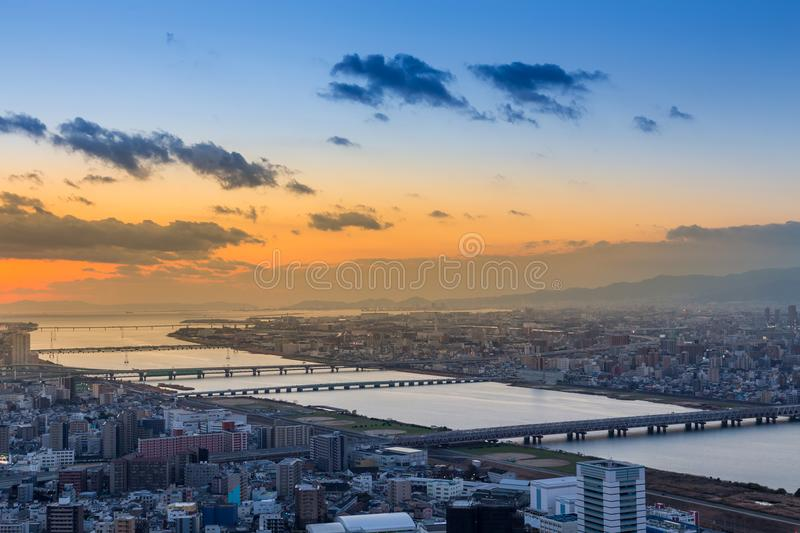 Sunset over Osaka city central business downtown skyline royalty free stock image