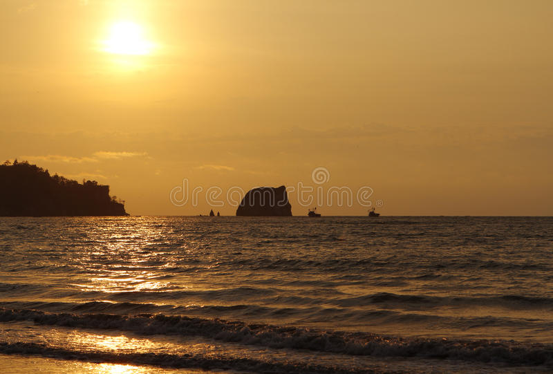 Sunset over pacific ocean. Seascape with the boats royalty free stock image