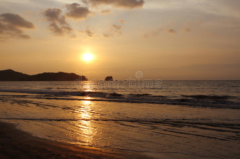 Sunset over pacific ocean. Shore seascape stock photos