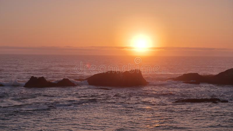 Sunset over Pacific ocean from a top of Sea Lion Rock beach, Oregon coast. stock image
