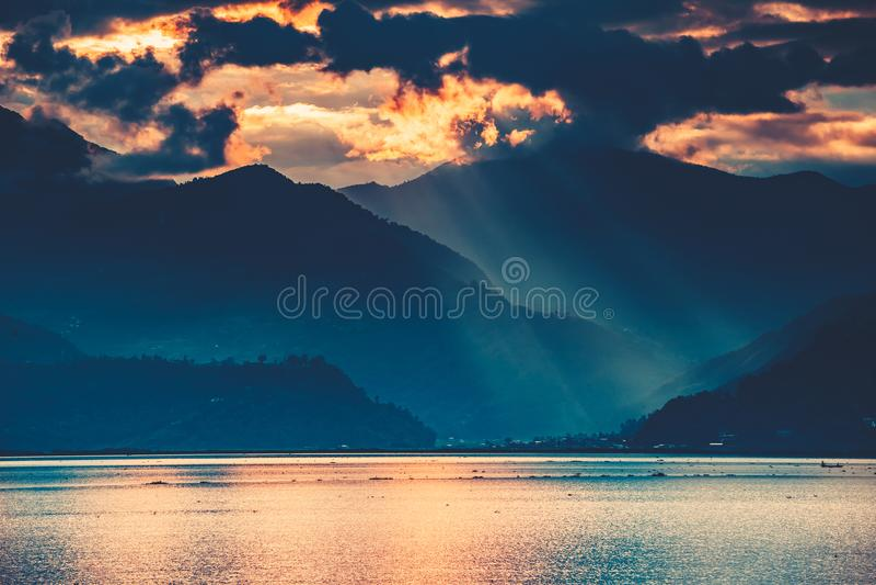 The sunset over the Phewa Lake. Pokhara. Nepal. stock image