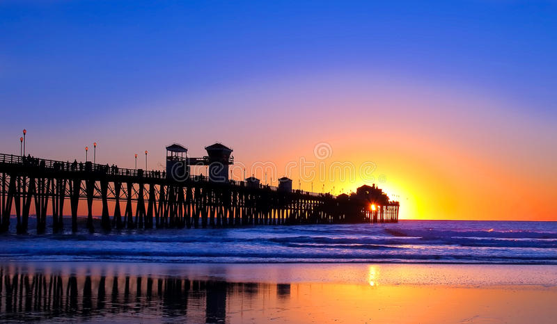 Sunset over a pier in California stock photography