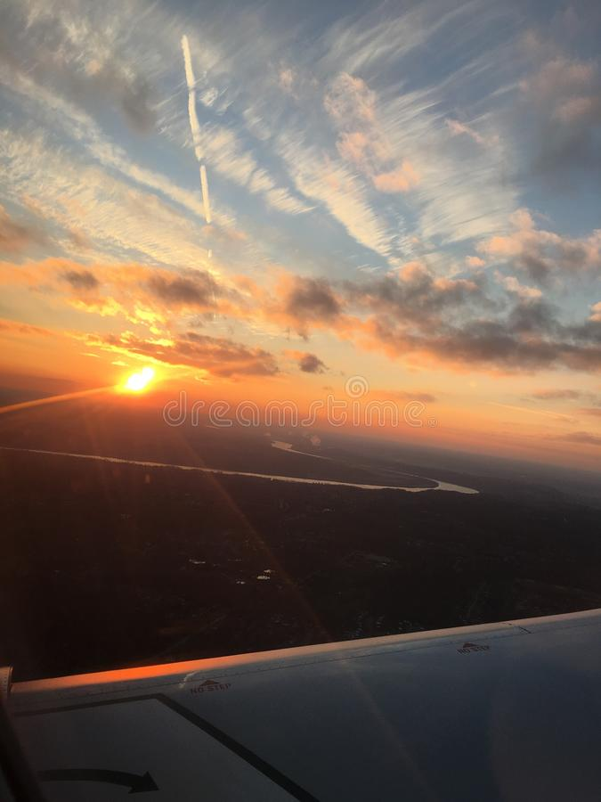 Sunset over plane wing royalty free stock image