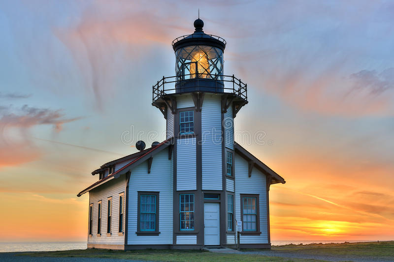 Sunset over Point Cabrillo Light Station State Historic Park, Mendocino County, California. Point Cabrillo Lighthouse with a beautiful sunset background royalty free stock image