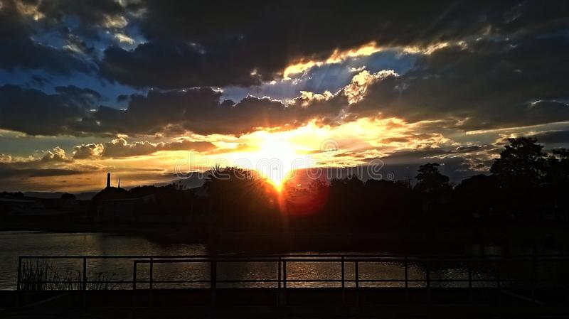 Sunset over pond stock photography