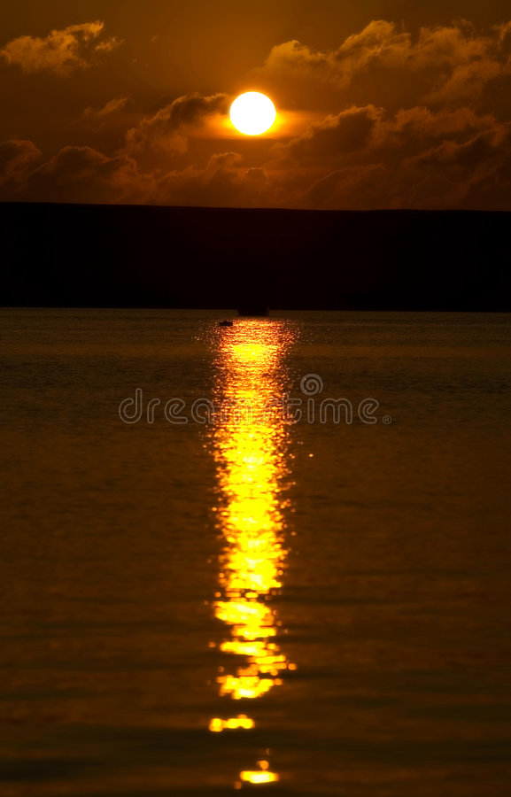 Sunset over Portland harbour in Dorset. Beautiful golden sunset over Portland harbour in Dorset stock photo