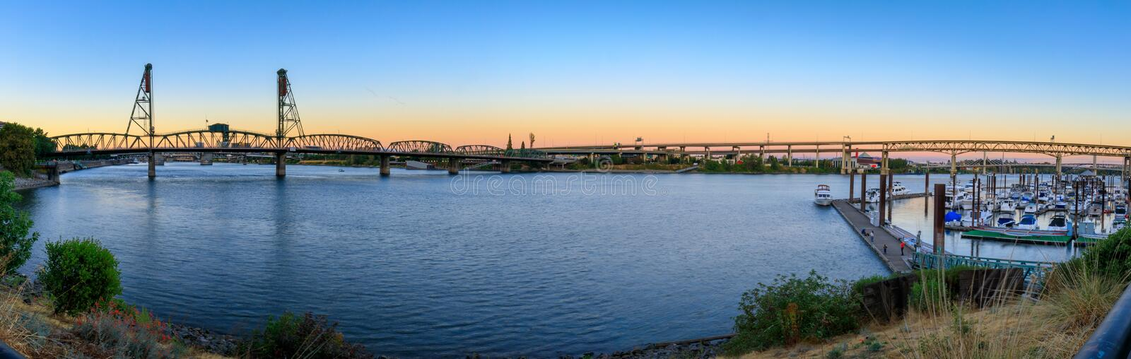 Sunset Over Portland Oregon City Skyline Along Willamette River Waterfront stock image