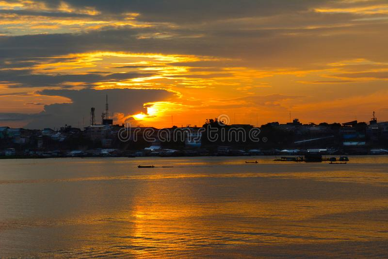 Sunset over the remote city in the Peruvian Amazon stock images