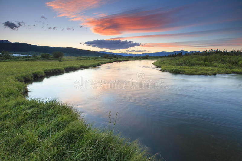 Sunset over the river. Beautiful sunset over the calm water of the river royalty free stock photo