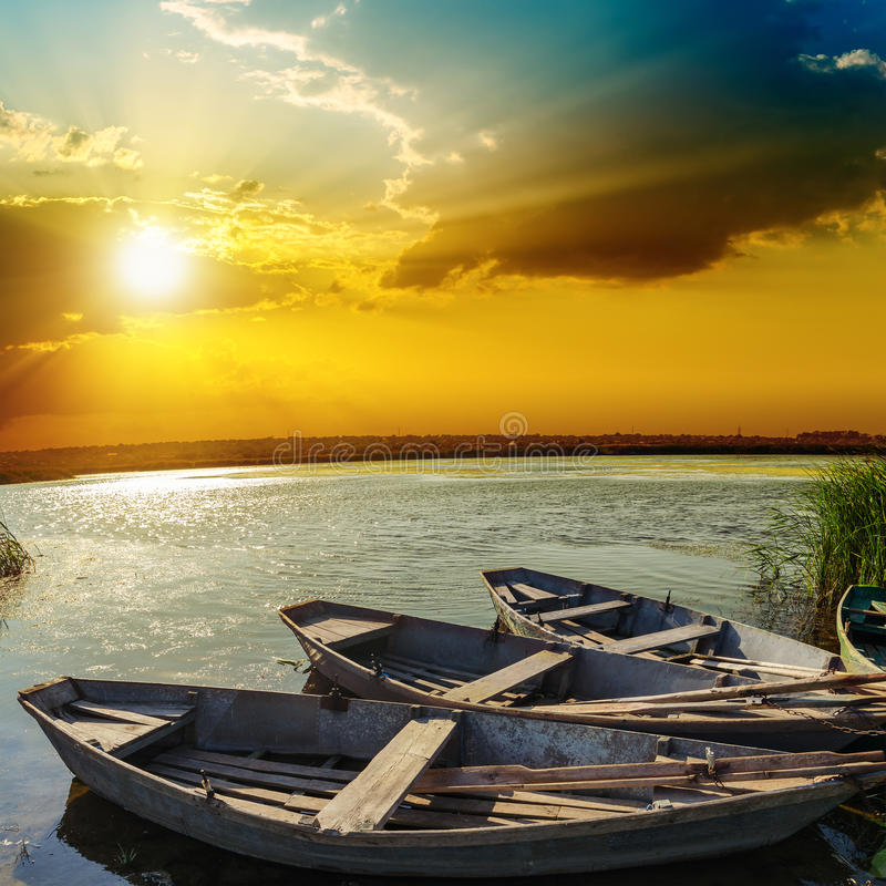 Sunset over river with boats royalty free stock image