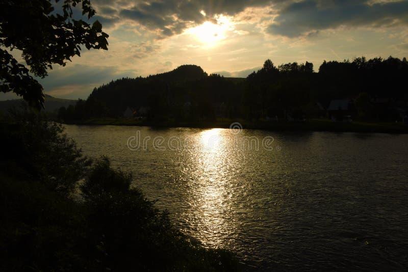 Sunset over river Dunajec. In village Stromowce Nizne and Cerveny Klastor royalty free stock image