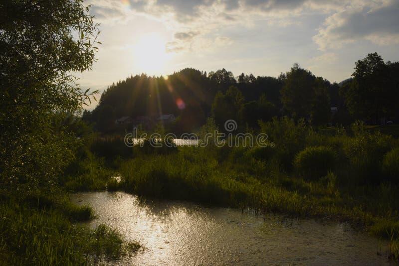 Sunset over river Dunajec. In village Stromowce Nizne and Cerveny Klastor stock photos