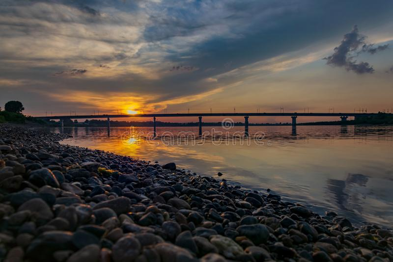 Sunset over the river overlooking the bridge royalty free stock photography
