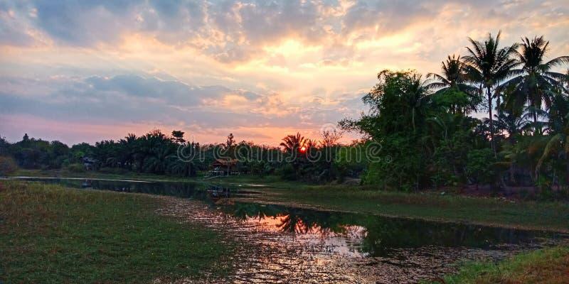 Sunset over a river stock photos