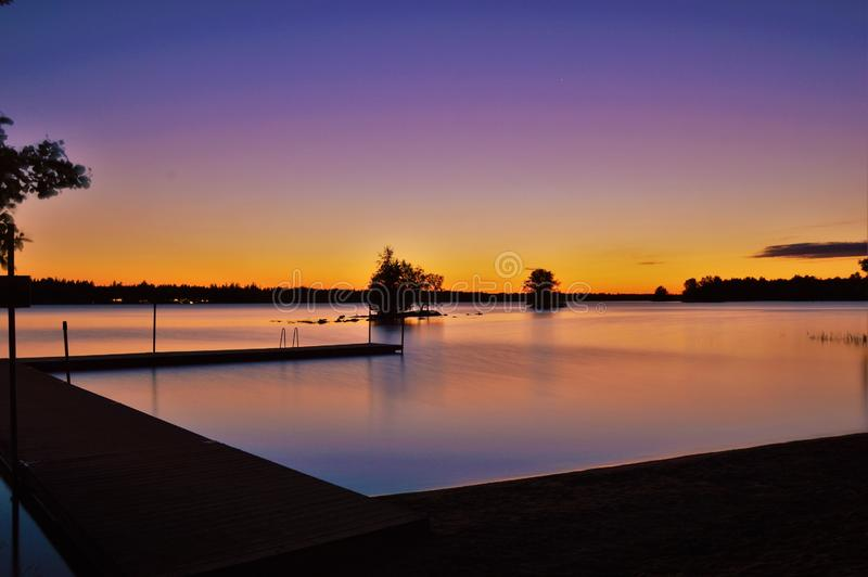 Sunset over river waterfront royalty free stock photo