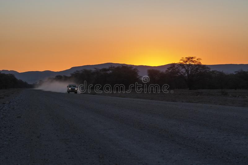Sunset over Road in Sesfontein at Joubert-Pass, Namibia royalty free stock photography