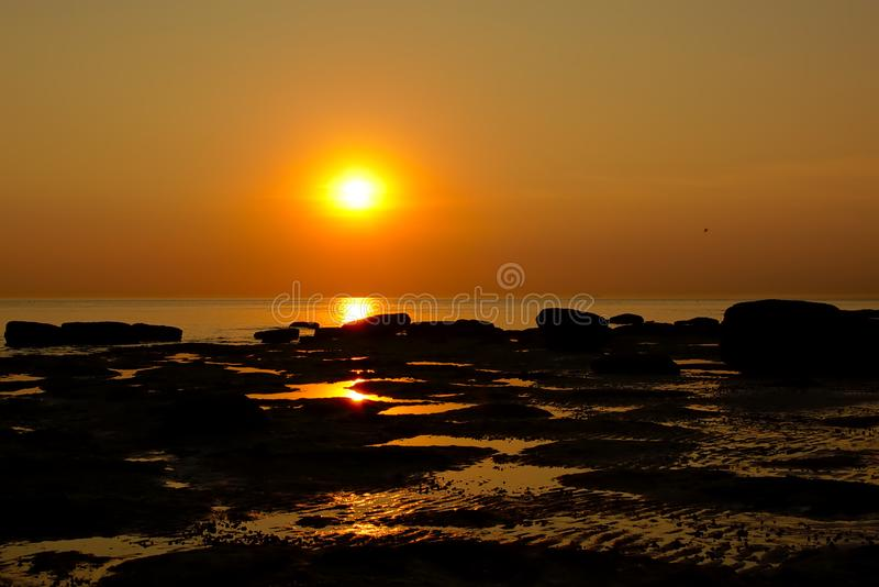 Sunset over the rock beach on the French north sea coast. Warm sunset over a rocky beach ont the French Opal north sea coast in Nord Pas de Calais region stock images