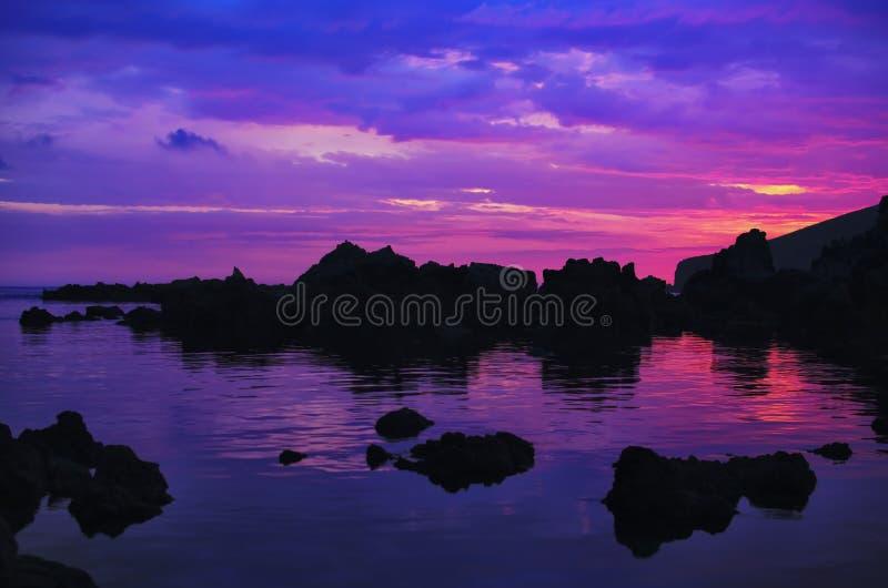 Sunset over rocks royalty free stock image