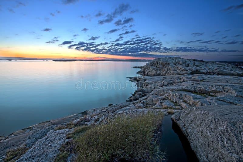 Sunset Over Rocky Coastline Royalty Free Stock Photos