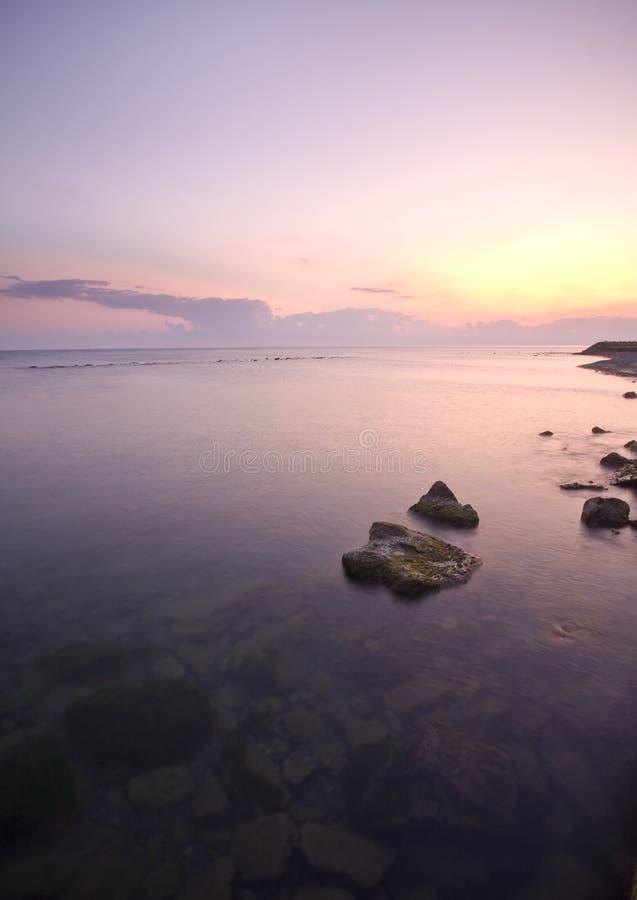 Sunset Over Rocky Coastline Stock Image