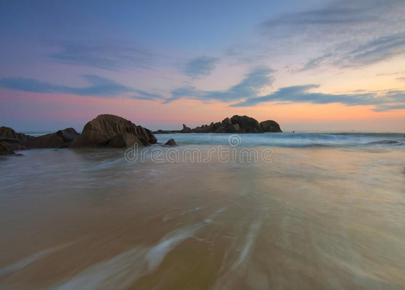 Sunset over rocky shores royalty free stock photography