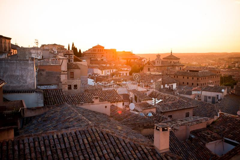 Sunset over roofs of old houses in Toledo - an ancient city with beautiful architecture near Madrid, Spain, Europe stock photography