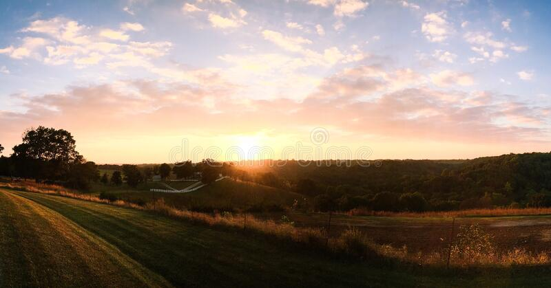 Sunset over rural hillside royalty free stock photos