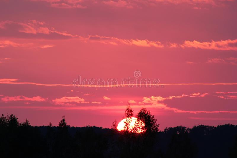 Sunset over rural landscape royalty free stock photos