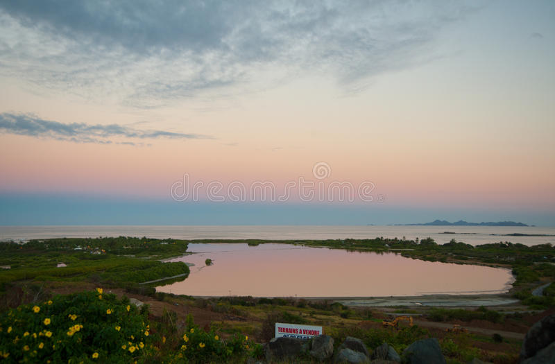 Sunset over Saint Martin. Colorful Saint Martin sunset over the sea and pond stock photos