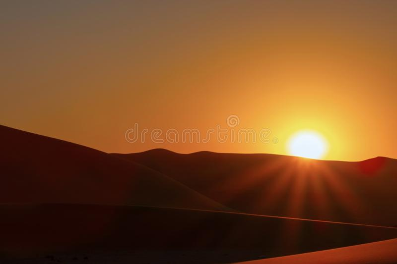 Sunset over the sand dunes in the desert. stock photography