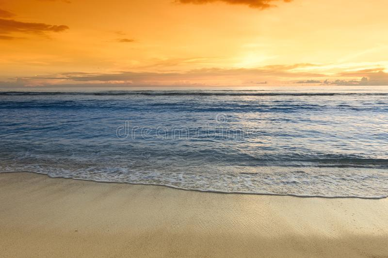 Sunset over sandy ocean beach royalty free stock photos
