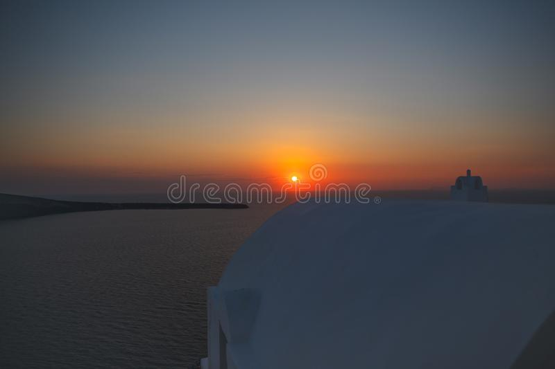 Sunset over Santorini island in Greece, apartments in Oia village on a sunset stock photos