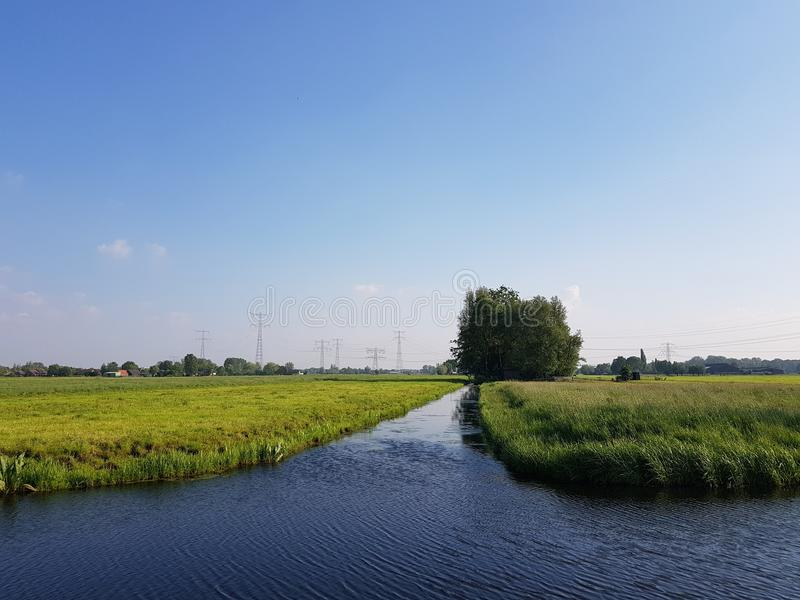 Sunset over the scenic countryside near Gouda, Holland. With cows and it`s many canals royalty free stock image