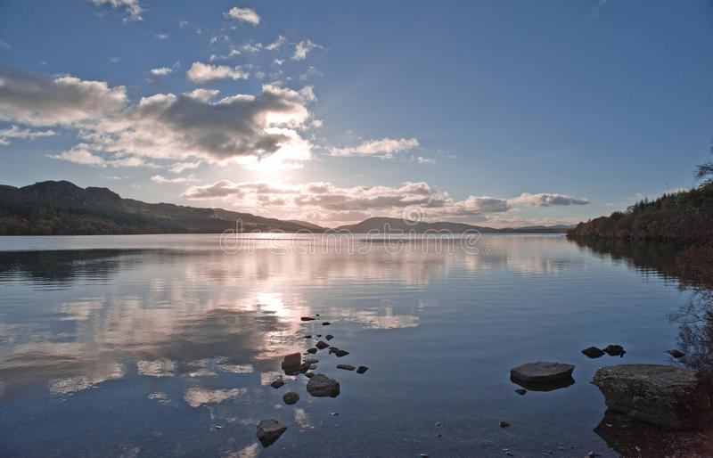 Sunset over Scottish Loch. An image of the sunset over a tranquil Scottish Loch in the Highlands royalty free stock photo