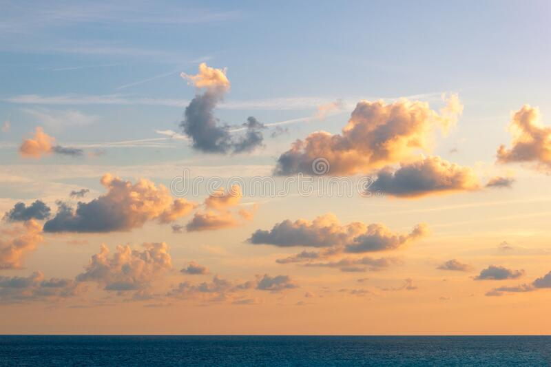 Sunset over the sea and beautiful cloud landscape. Gold sea sunset, wallpaper. Sunset over the sea and beautiful cloud landscape. Gold sea sunset, wallpaper royalty free stock photography