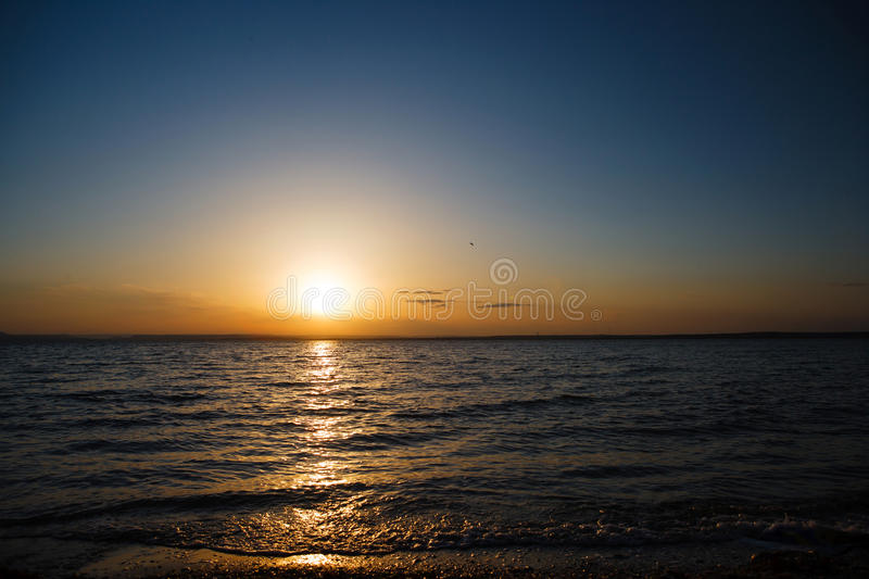 Sunset over the sea, a beautiful evening ocean. royalty free stock photo