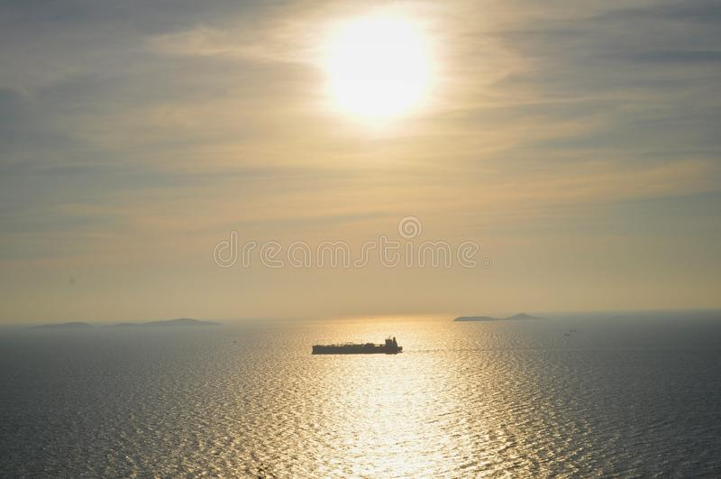 Sunset over the sea with a boat stock photos