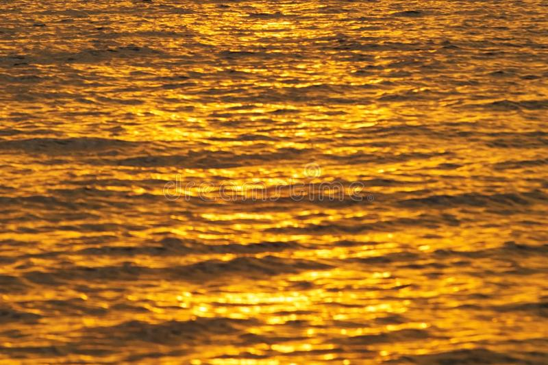 Sunset over sea or ocean with water texture stock image