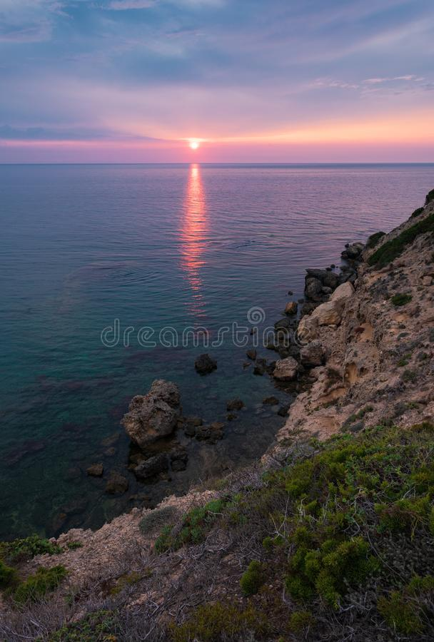 Sunset over the sea in the Sardinian west coast, Italy royalty free stock photography