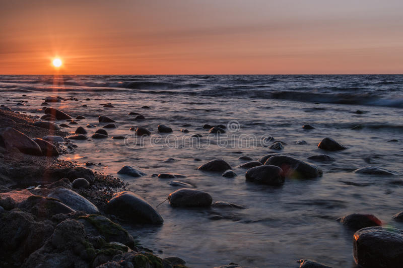 Sunset over the sea. Stone on the foreground. Sunset over the sea. Stone on the foreground stock photos