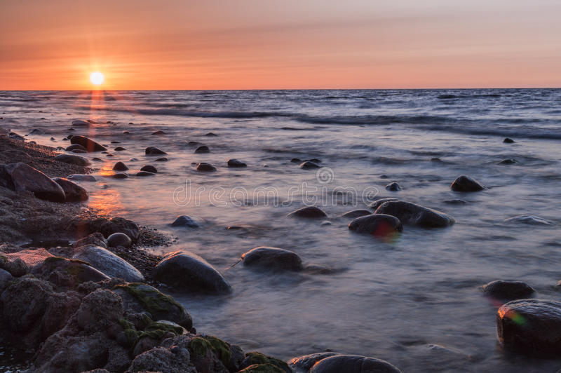 Sunset over the sea. Stone on the foreground. Sunset over the sea. Stone on the foreground royalty free stock images